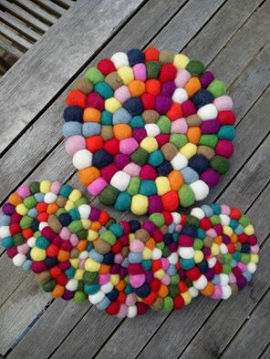 multicoloured felt ball trivet