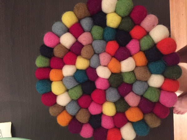 multicolored felt ball trivet