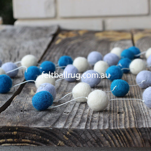 Blue and white felt ball garland