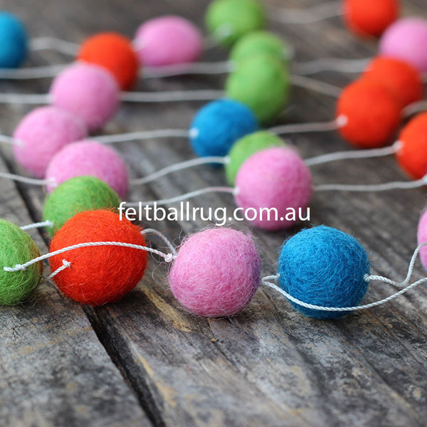 felt ball garland pink red green and blue