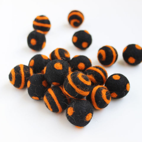 Polka Dot Swirl Felt Balls Orange On Black