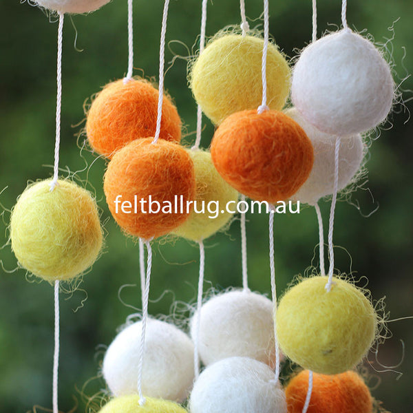 felt ball garland yellow orange white