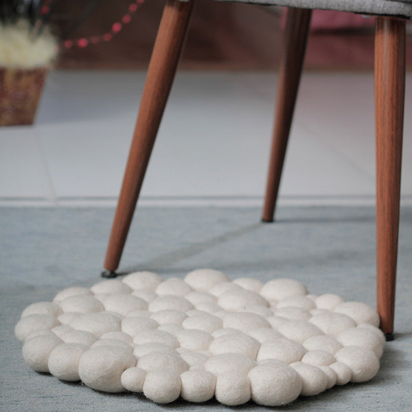 white pebble felt ball rug