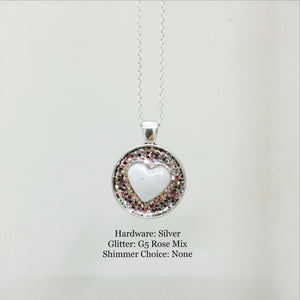 MILK HEART BEAD ON ANTIQUE PLATE PENDANT
