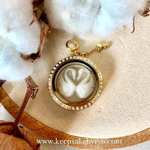 PAIR OF SWANS BREASTMILK GLASS LOCKET