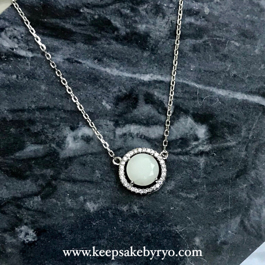 SOLITAIRE: PAVE CIRCLE PENDANT WITH BREASTMILK STONE
