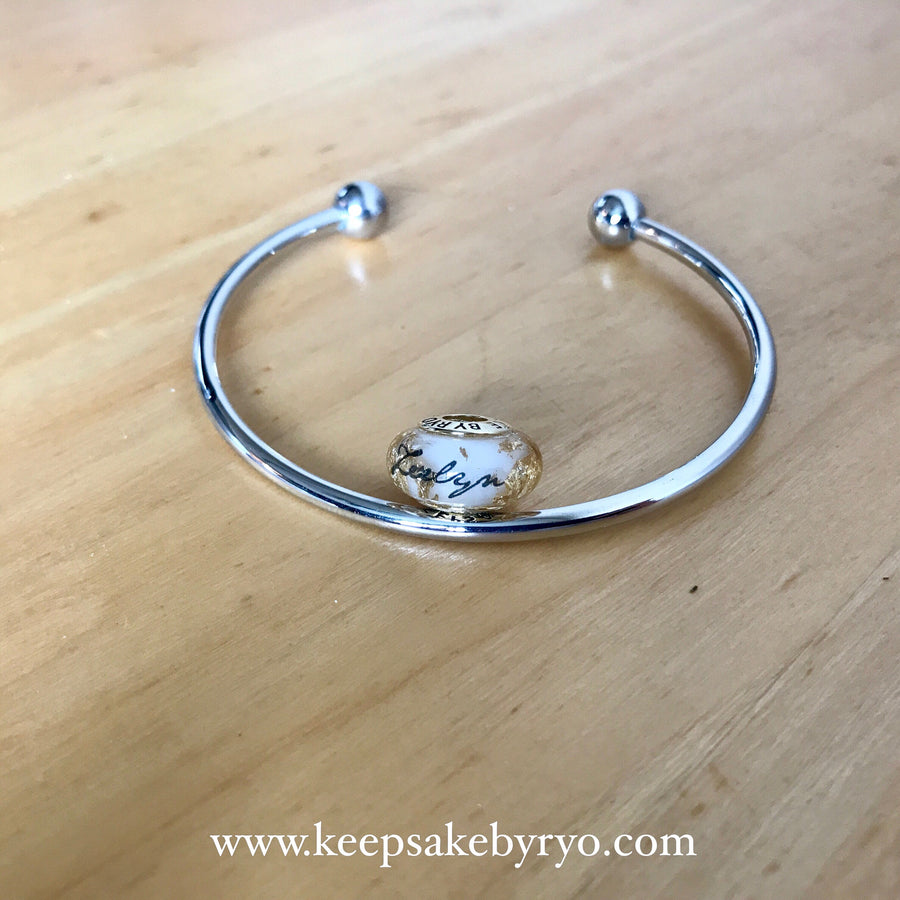 BREASTMILK CHARM WITH PRECIOUS METAL FLAKES