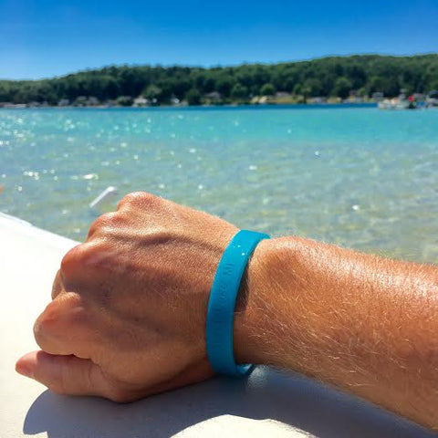 Torch Lake Cleanup with Stand Up for the Great Lakes with Kwin Morris blue wrist band