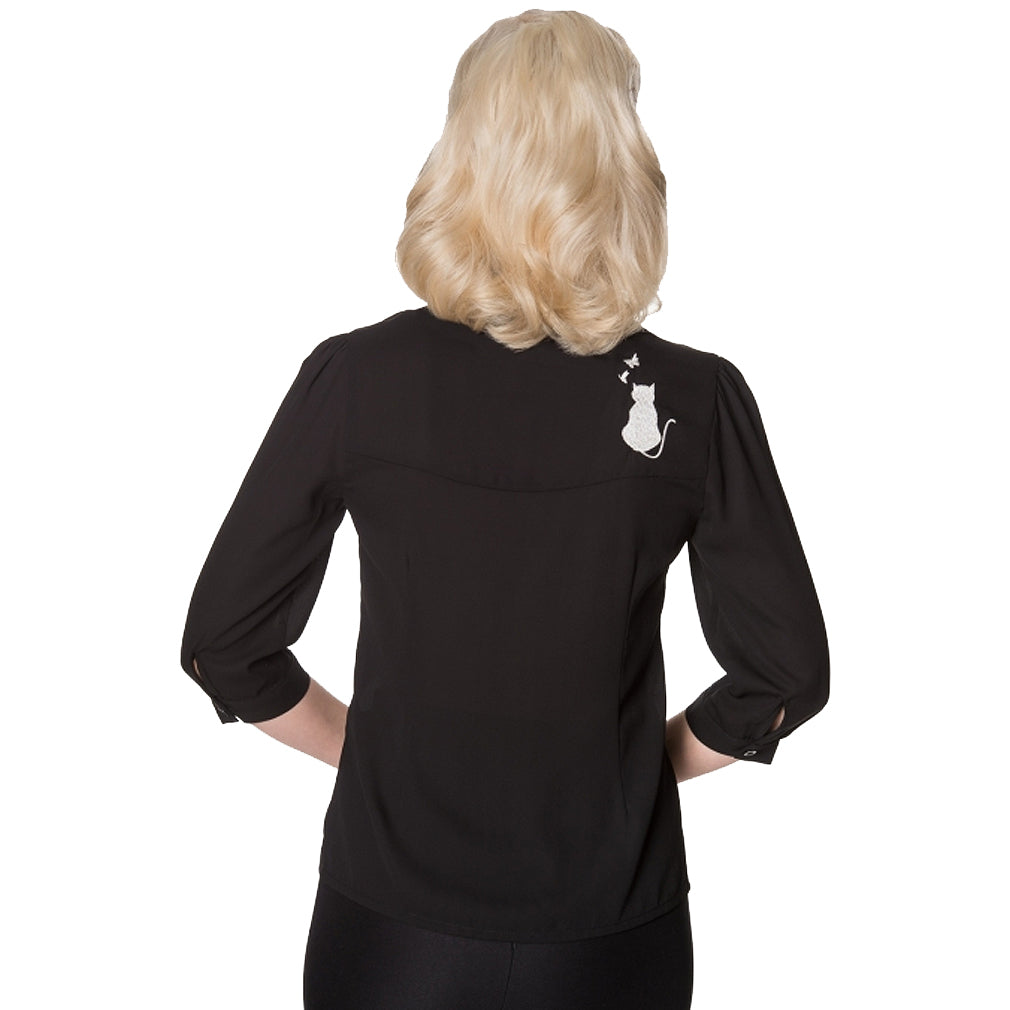 Image of back of blouse