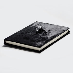 BLACK CAPRINAE NOTEBOOK
