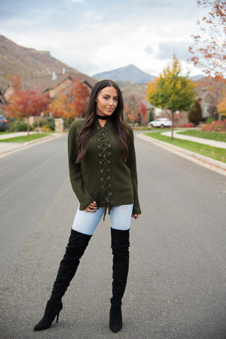 Women's olive green knit lace up sweater. Made from 75% acrylic and 25% mohair. The loose design allows for a comfortable fit, while the front shows off a little bit of skin for a sexy touch.