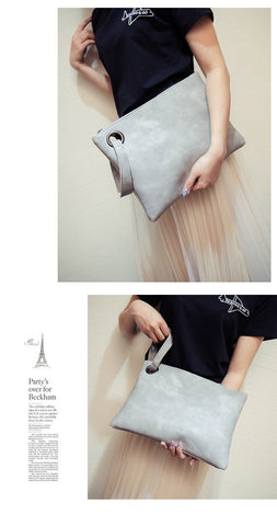 Image of Leather Grommet Envelope Clutch Virtual Glam Shop