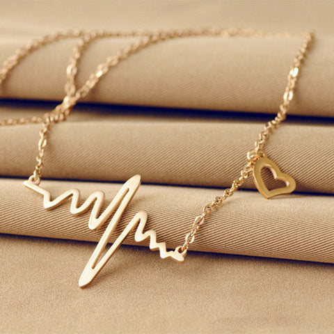 Image of Simple Wave Heartbeat Necklace Gold Virtual Glam Shop