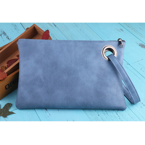 Image of Leather Grommet Envelope Clutch Sky Blue Virtual Glam Shop