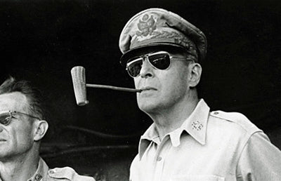 General Douglas MacArthur with aviator style glasses and his signature corncob pipe in the Philippines in 1945.