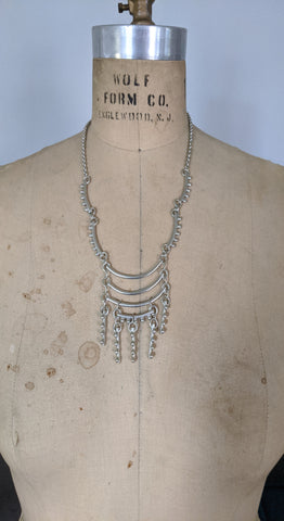 Silver Echoes long dramatic necklace