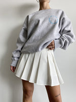 Fair game pleated mini skirt