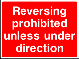 Reversing Prohibited Unless Under Direction Sign.