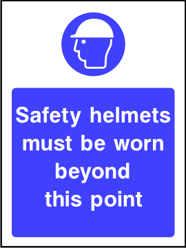 Safety helmets must be worn beyond this point sign.