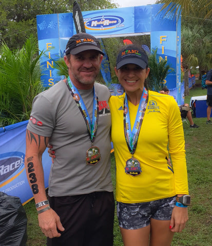 Karen and Doug Monda race finish medal
