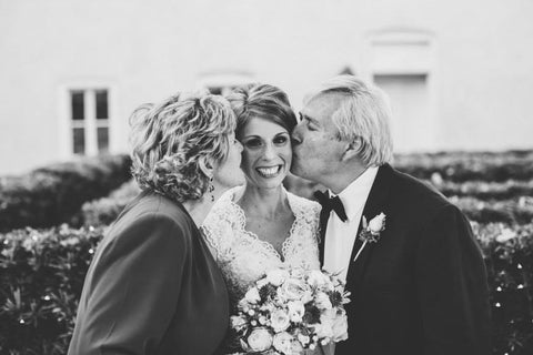 lynsey capone smith and parents wedding day kiss cheek flowers