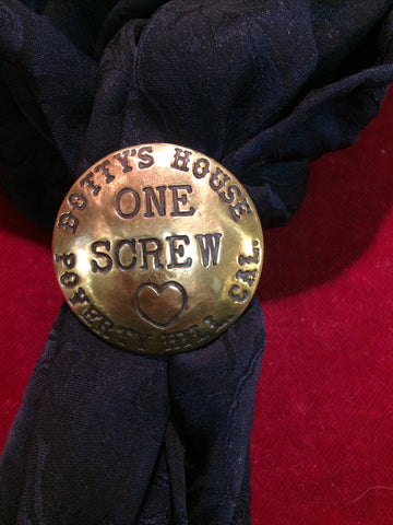 "Scarf Slide: Brass token, Dotty""s House, California"