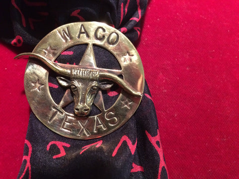 Scarf Slide: Brass Steer on brass cut out star marked WACO, TEXAS