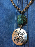 Necklace:  100 year old Tibet Turquoise bead and sterling Shamrock pendent