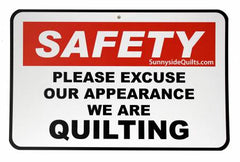 """Safety Please Excuse Our Appearance We Are Quilting"" Sign 8-1/2in x 5-1/2in"
