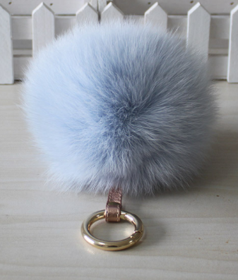 Fur Pom Pom with leather strap