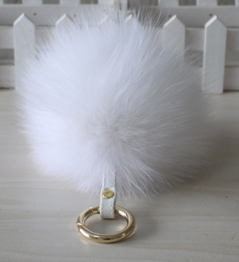 Fur leather Pom Pom with leather strap