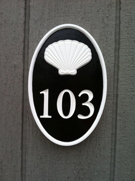 custom carved oval house number sign with scallop shell painted black and white