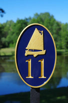 Any color Carved House number with gold catboat on navy background front