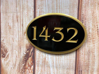 1432 black and gold oval house number sign