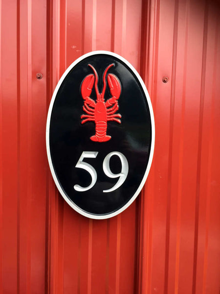 Black silver and red oval house number sign with lobster image
