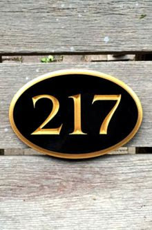 Oval house number sign - black and gold - front view