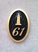 oval house number sign with lighthouse front view
