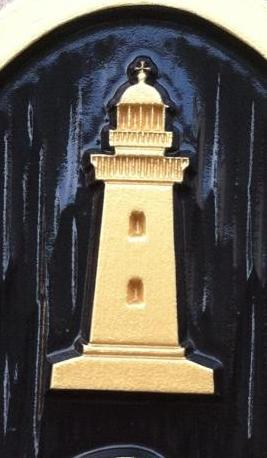 Lighthouse carved on custom oval house number sign