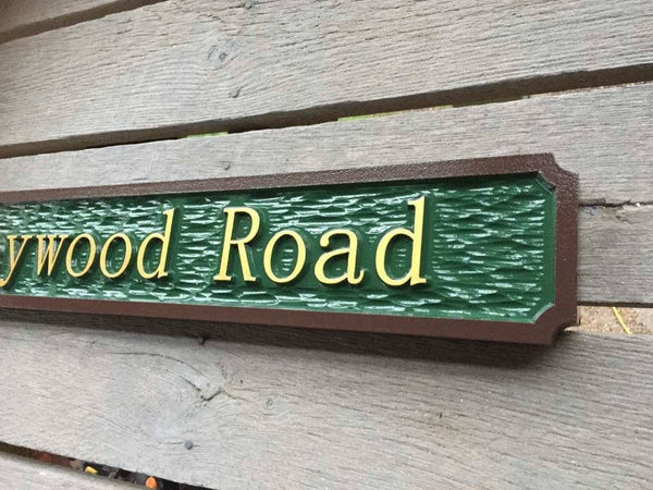 62 heywood road street name sign custom made angle view painted green brown and gold