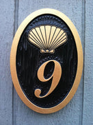 oval house number plaque with shell image nautical theme