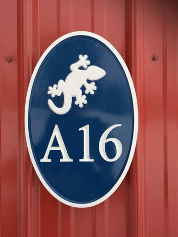 A16 with Gecko carved on oval navy blue and white sign