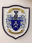 Baczewski Family crest carved and painted in white and blues
