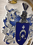 Side view of Baczewski Family crest carved and painted in white and blues