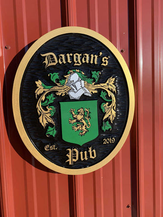 Family Crest for Dargan painted green gold and black