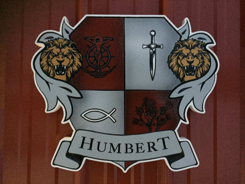Custom carved and painted Humbert family crest