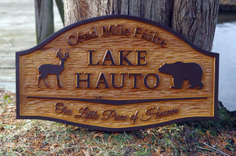 Cedar carved camp sign with buck and bear