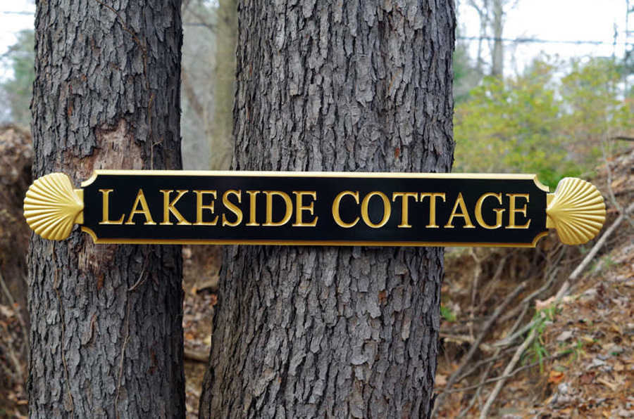 Lakeside Cottage quarterboard with decorative scallop ends painted black and gold