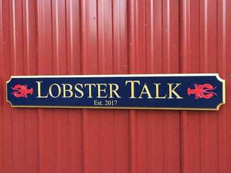 quarterboard sign with lobsters and Lobster Talk wording carved on it