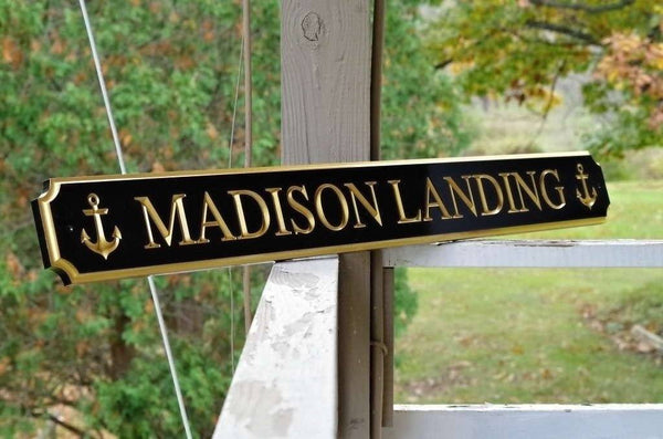 Custom made quarterboard with anchor images saying Madison Landing
