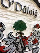 Close up of O-Dalaig family shield custom carved and painted